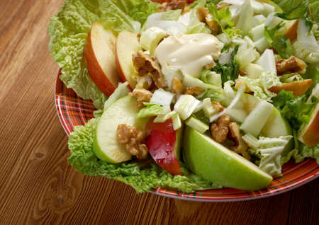 Waldorf salad made of fresh apples, celery and walnuts.farm-style photo