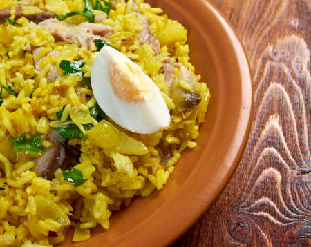 kipper: Scottish dish - Kedgeree, flakes of smoked herring baked with rice, milk,  parsley, and served with hard-boiled eggs.