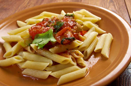 marinara: plate of penne rigata pasta with marinara sauce.