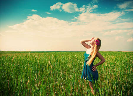 happy woman on green grass on background photo