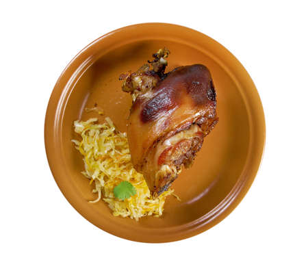 Berliner Eisbein.grilled knuckle of pork with sauerkraut .isolated photo
