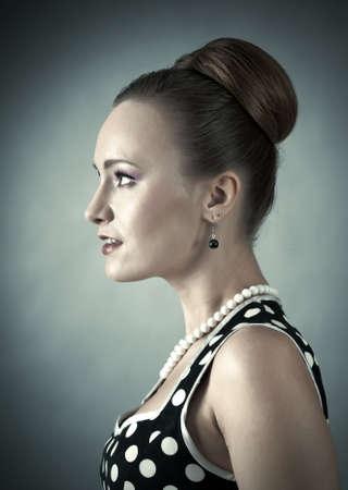 Girl in american 60s style in  polka dot dress  photo