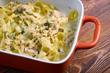 Pasta fettuccine with salmon in a cream sauce.Baked cheese pasta photo