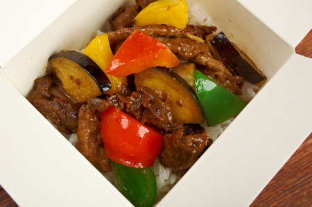 delicious oriental fried rice tyahan -  meat and oyster sauce, chinese cuisine.in take-out box photo