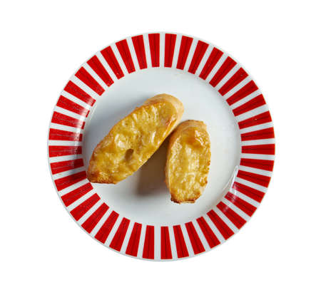 uk cuisine: Welsh Rarebit - Toasted  bread with melted cheddar cheese  Stock Photo