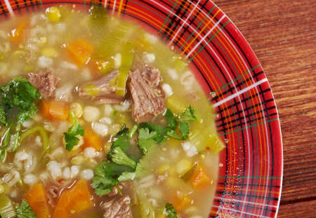 uk cuisine: Scotch Broth Soup.farmhouse kitchen.old fashioned thrifty soup made from meat on the bon