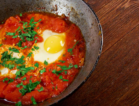 traditionally: Shakshuka -dish of eggs poached in a sauce of tomatoes, chili peppers, and onions, often spiced with cumin Moroccan, Tunisian, Libyan, Algerian, and Egyptian cuisines traditionally
