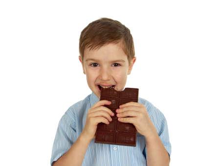 cikolata: Smiling  funny young kid eating chocolate.White isolated Stock Photo