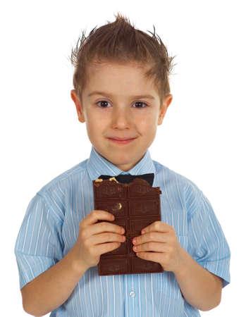 cikolata: Smiling young kid eating chocolate Stock Photo
