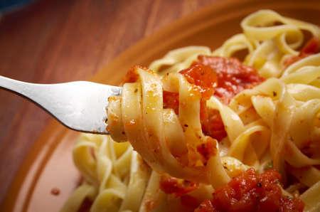 marinara: Sicilian homemade   pasta  Fettuccine with marinara sauce .farm-style