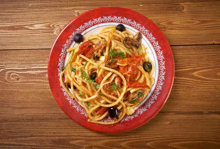 puttanesca: Spaghetti alla puttanesca salty Italian pasta dish