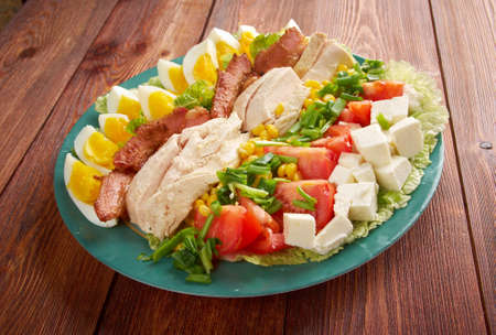 entree: Cobb Salad - Colorful hearty entree sized salad with bacon, chicken, boiled eggs, corn