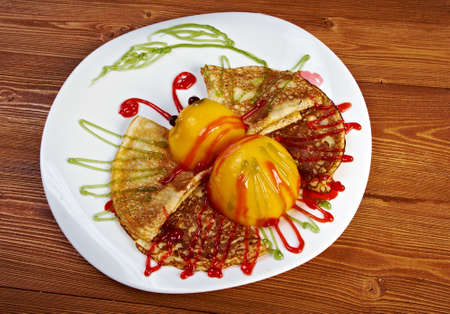 butterfly shaped pancake with peach photo