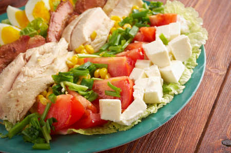 entree: Cobb Salad - Colorful hearty entree sized  salad with bacon, chicken, boiled eggs, corn, -  a main-dish American garden salad
