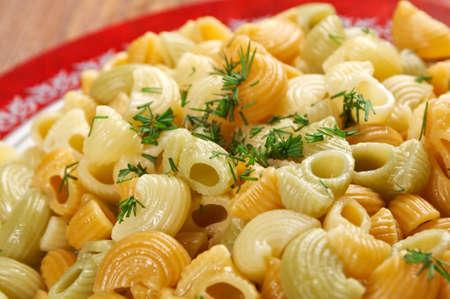 enrich: closeup of Colorful Italian conchiglie gourmet pasta