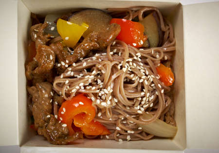 take-out food -Noodles with pork and vegetables in take-out box photo