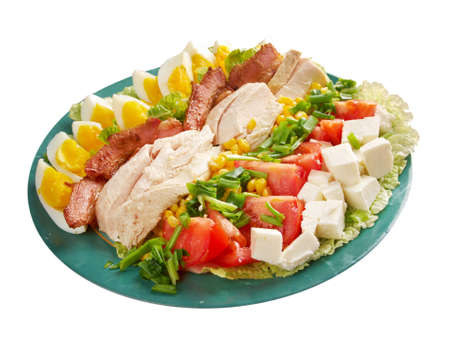 Cobb Salad - Colorful hearty entree sized  salad with bacon, chicken, boiled eggs, corn, -  a main-dish American garden salad ,isolated  photo