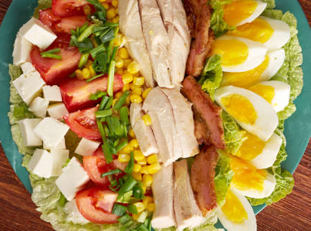 Cobb Salad - Colorful hearty entree sized  salad with bacon, chicken, boiled eggs, corn, -  a main-dish American garden salad  photo
