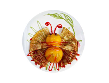 Kids Food.Fun butterfly shaped pancake with peach photo