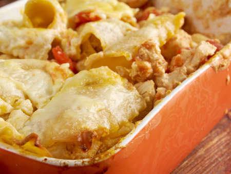 Chicken and Pumpkin Lasagna  in ceramic casserole dish, close up photo
