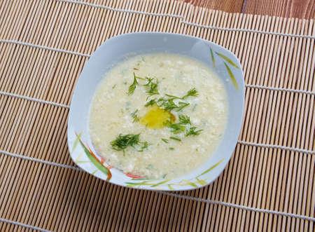 stracciatella: Stracciatella -  Italian food. Stracciatella alla romana is an egg drop soup which is popular around Rome in the Lazio region of central Italy Stock Photo