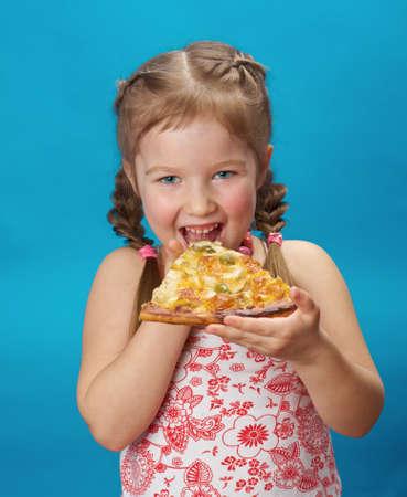 little girl eating pizza photo
