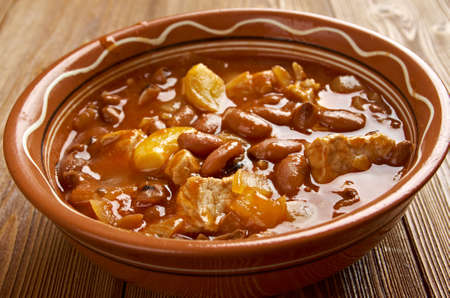 Frijoles Charros - traditional Mexican dish. by pinto beans stewed with onion, garlic, and bacon.
