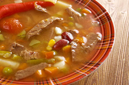 A thick and hearty spicy Mexican soup. (like chili con carne) photo