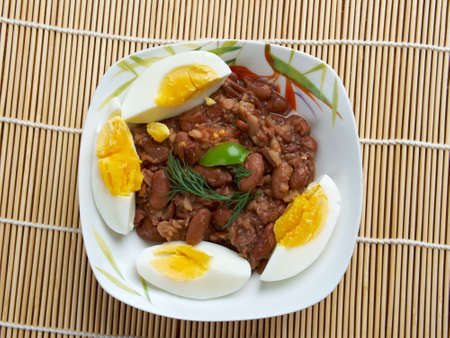 ful: Ful medames - Egyptian,Sudanese dish of cooked and mashed fava beans served with vegetable oil, Stock Photo