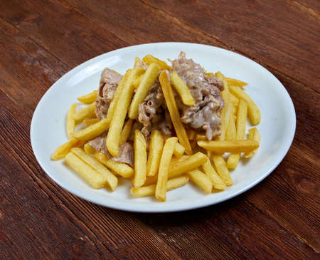 Slice pork  and french fries. close up photo