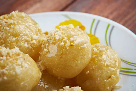 zeppole: Loukoumades Greek pastry made of deep fried dough soaked in sugar syrup or honey and cinnamon.found in the Mediterranean, Middle East, and South Asia, from the Italian