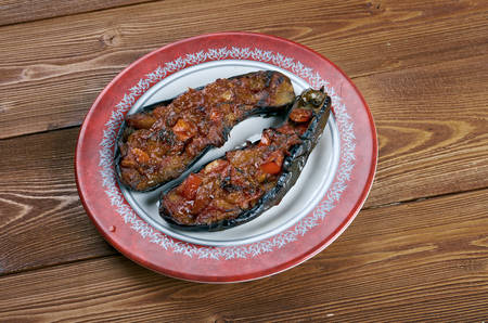 Imam bayildi - dishes found in Turkish cuisine.whole braised eggplant stuffed with onion, garlic and tomatoes, photo