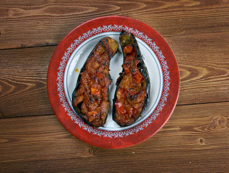 Imam bayildi - dishes found in Turkish cuisine whole braised eggplant stuffed with onion, garlic and tomatoes, photo