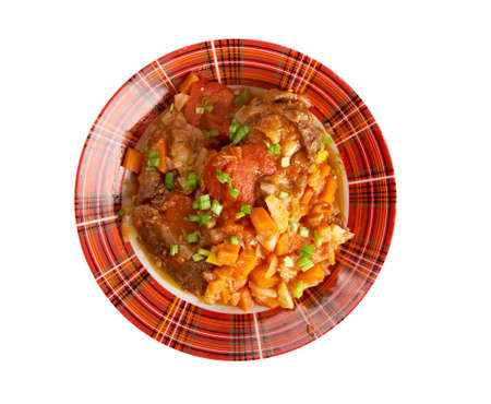 crosscut: Ossobuco - Italiano country cuisine .Milanese specialty of cross-cut veal shanks braised with vegetables