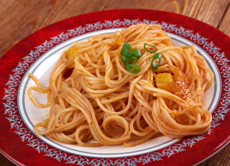 pastasciutta: Pasta asciutta -   pastasciutta cooked pasta is plated and served with a complementary sauce or condiment Stock Photo