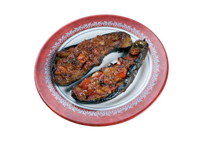 imam: Imam bayildi - dishes found in Turkish cuisine.whole braised eggplant stuffed with onion, garlic and tomatoes,
