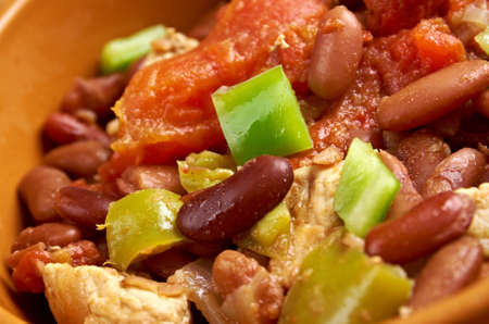 "Chili con carne - in American English as simply ""chili"", is a spicy stew containing chili peppers, meat (usually beef), tomatoes and often beans photo"
