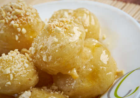 zeppole: Loukoumades Greek pastry made of deep fried dough soaked in sugar syrup or honey and cinnamon.