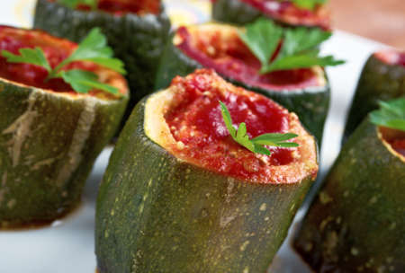 Cuor di zucchina -italian baked zucchini stuffed with cheese and tomatoes photo