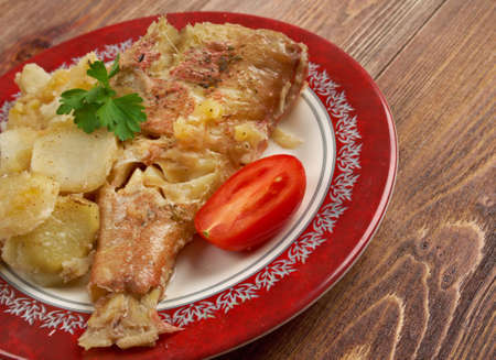 Baked red grouper with potato and  apple photo