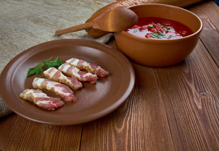 farmhouse kitchen lunch uncooked dried bacon and beet soup photo
