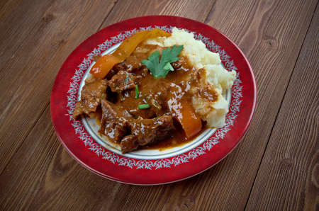 lt: Porkolt - Pörkölt,meat stew which originates from Hungary, but is eaten throughout Central Europe and the Balkans. Stock Photo