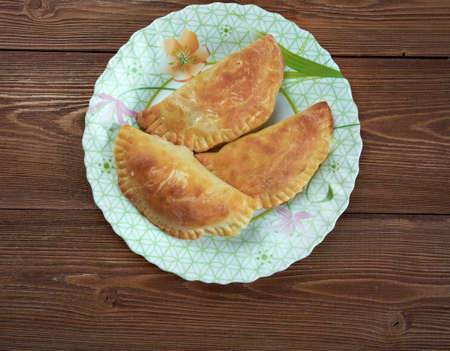 southeast europe: Empanada - Argentine fried meat  pate.stuffed bread or pastry baked or fried in many countries in Latin Europe, Latin America, the Southwestern United States, and parts of Southeast Asia Stock Photo