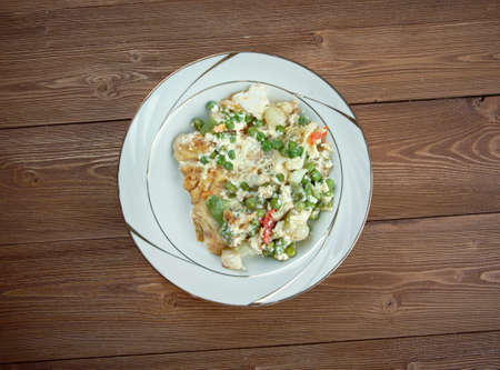 fricassee: Fricassee of white fish. traditionally a white sauce. Stock Photo