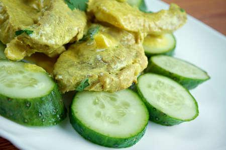 porc: Curry de porc aux concombres  - pork in curry sauce and cucumber close up