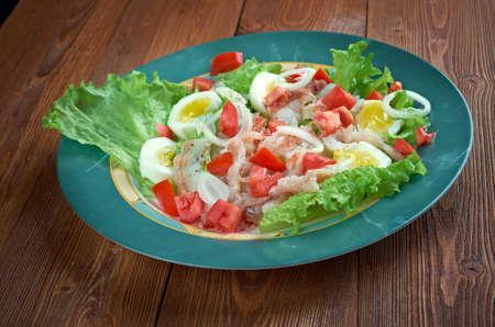 escarole: Ensalada de bacalao - salted cod salad.Traditional Catalan salad Stock Photo