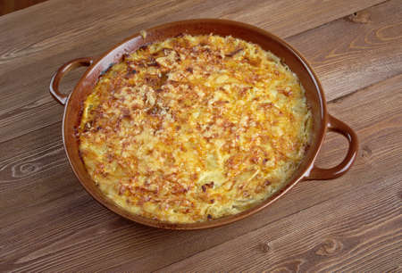 french cuisine: Tian de courgettes - French cuisine. casserole with zucchini and cheese