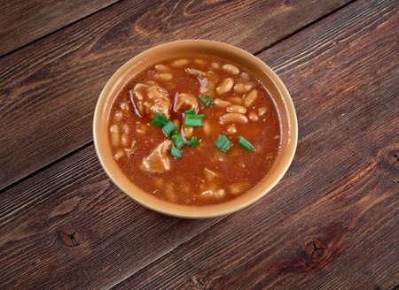 kuru: Kuru fasulye -  turkish bean stew with  tomato sauce. Stock Photo
