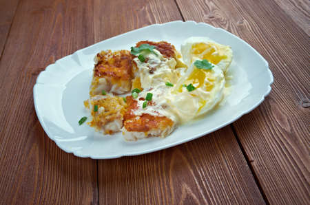 haddock: Finnan Haddie -  traditional Scottish  breakfast. smoked haddock cooked with egg and sauce