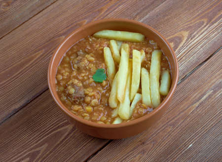 mesopotamian: Gheimeh - Persian and Mesopotamian stew of which the main ingredients are meat, tomatoes, split peas, onion Stock Photo